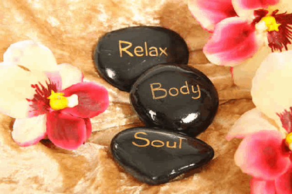Hot stones with the words relax, body and soul on them
